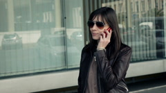 Attractive woman talking on cellphone in the city, super slow motion. Stock Footage