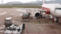 Airport crew outside the Malaysia airport Stock Footage