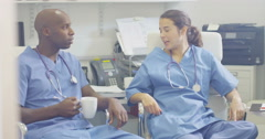 4K Cheerful colleagues in medical industry chatting during break time in office. Stock Footage