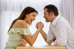 Man and Woman arm wresting - stock photo