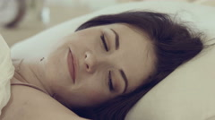 Morning awakening of the young beautiful girl Stock Footage