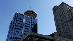 Modern business building and Vancouver lookout tower Stock Footage