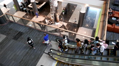Top shot of people taking escalator inside Pan pacific Vancouver hotel Stock Footage