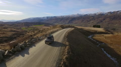 4x4 car driving on gravel road to Cardrona mountain 2 Stock Footage
