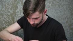 Cutting man's beard with the straight razor Stock Footage