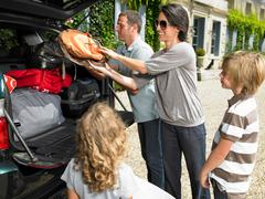Family charging bags in the trunk Stock Photos