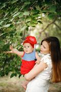 Cute Happy Child with Mother - stock photo