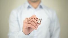 Racism,  Man writing on transparent screen - stock footage