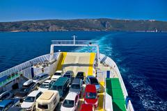 Ferry boat tourist line to island - stock photo