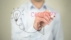 Creativity, Glowing Bulb Concept, Man writing on transparent screen - stock footage