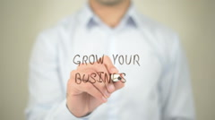Grow Your Business,  Man writing on transparent screen - stock footage