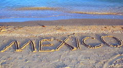 Tropical beach and Mexico writing on sand Stock Footage