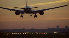 4K Big airplane landing at dusk Stock Footage