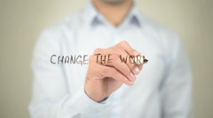 Change the World,  Man writing on transparent screen - stock footage