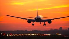 4K Boeing 777 landing at sunrise Stock Footage