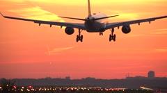 4K Sunrise airplane landing Stock Footage