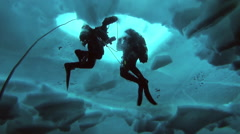 Divers under the water against the background of open water at the North Pole in Stock Footage