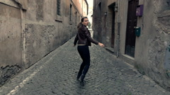 Afraid, scared woman running through street in the city,  super slow motion Stock Footage