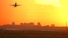 4K airplane takeoff at sunrise - stock footage