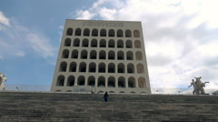 Young woman running up the stairs od Pallazo della Civita in Roma, 240fps Stock Footage