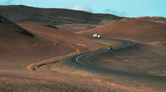 Cars driving on an Icelandic highway through mountains Stock Footage