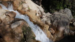White mountain stream water falling down Stock Footage