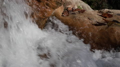 White mountain stream water falling down - stock footage