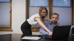 Sexy assistant and her boss. The scene in the office, young secretary, help the Stock Footage
