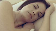 Alarm clock wake up the sleeping girl Stock Footage