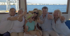 Family on board the ship showing thumbs-up Stock Footage