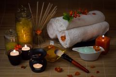 Close-up. Spa still life. Sea salt bath, massage oil, candles, flowers and to - stock photo