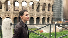 Young, pretty woman walking close to the Colloseum in Rome, super slow motion Stock Footage