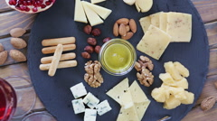 Top view cheese plate Assortment of various types of cheese - stock footage