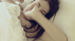 Positive girl lying in bed in the morning Stock Footage