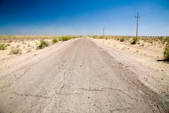 Cracked road stretching through the desert Kuvituskuvat