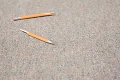 Pencil that has been snapped in frustration - stock photo