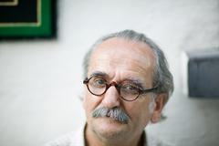 Portrait of a senior man with a mustache - stock photo