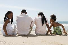 African american family on a beach Stock Photos