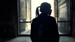 Young woman walking through museum Stock Footage