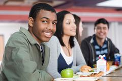 School students having lunch - stock photo