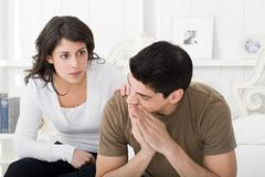 Concerned looking couple Stock Photos