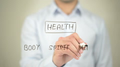 Health, Clip Art,  Man writing on transparent screen - stock footage