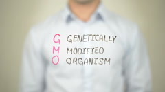 gmo genetically modified organism , Man writing on transparent screen - stock footage
