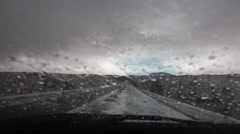 4K Driving POV Windshield Wipers Swish Rain Wet Road Dark Clouds Stock Footage