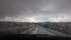 4K Driving POV Windshield Wipers Swish Rain Wet Road Dark Clouds Stock Footage