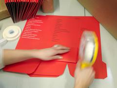 Worker Finishing Print Work By Hand Stock Photos