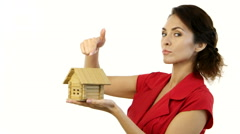 Angry woman holding a little house in her hands and destroy home Stock Footage