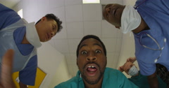 4K Hospital emergency team rush a patient on a gurney to the operating room Stock Footage