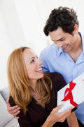 Young couple with with gift Stock Photos