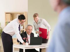 An informal office meeting Stock Photos